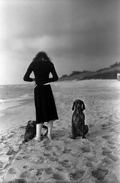 woman with dog | Photographer: Henri Cartier-Bresson