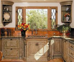 Love the Old World look of the cabinets and the copper backsplash.