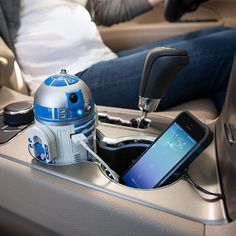 The R2-D2 USB Car Charger from ThinkGeek is the perfect travel companion for people who need to stay connected while driving.