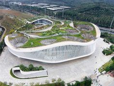 The green roof of the new Nanning Planning Exhibition Hall in China is an elevated urban park that that brings institutional architecture back to the people. Designed by Zhubo Design Zstudio, the building acts as an artificial mountain, expanding the existing park and adding a new public space for city dwellers.