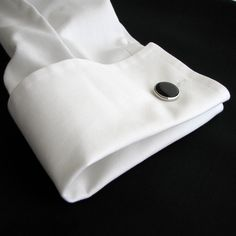 Cuffs and collars are the foregraund shapes in clothing.