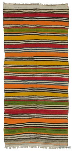 Vintage colorful striped kilim rug handwoven in Turkey in 1960's. This tribal rug with modern appeal is in very good condition.