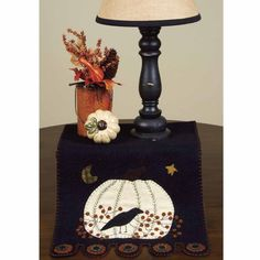 CountryPorchHomeDecor.com features this Pumpkin And Crow Table Runner.