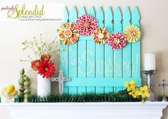 spring DIY backdrop - picket fence and medallions - red, yellow, turq