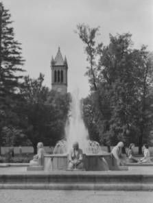 The Memorial Union fountain  in spring with the Campanile towering over the trees in the background. 1941, Campus Iowa State University, Ames, Iowa.