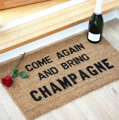 This doormat is just perfect for us Champagne lovers, and a great housewarming gift for friends. 'Come again and bring Champagne'.Designed by, and exclusive to, award-winning typographic art boutique More Than Words. Make a statement in the neighbourhood, with this 15mm internal coir coconut husk mat with black text. Ideal for internal and sheltered areas of your home, removing dirt and water from boots and shoes. To clean, simply shake and brush down.Made from natural coir and a pvc…