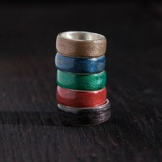 Handmade bentwood ring made from broken skateboards with silver band inside - wooden box included. Like every skateboard, it contains 7 colorful layers of canadian maple - really hard wood. Our rings are impregnated with the special waterproof cover which is neutral for skin. Because of