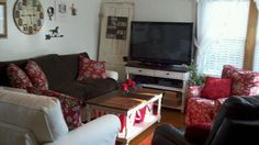 The living room after I rearranged it. I cover the sofa with a brown blanket to protect it from a 10 year old.