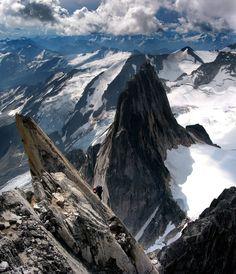 Climber on Kain/South Ridge Route of Bugaboo Spire - Bugaboo Glacier Provincial Park, British Columbia, Canada