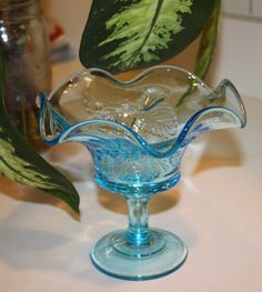 This unique blue glass candy bowl was made in the 1940s. The patteon this candy…
