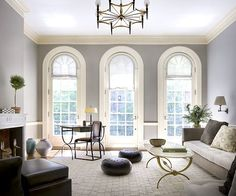 Paint: Revere Pewter, Benjamin Moore. Cream trim. The plants in this room look amazing against the gray and white.