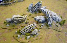 these amazing rocks are made from foam covered in filler, then brushed with a wire bristled brush to create the strata. I've been using wood bark, but its too small for big formations. this would be perfect for larger hills.