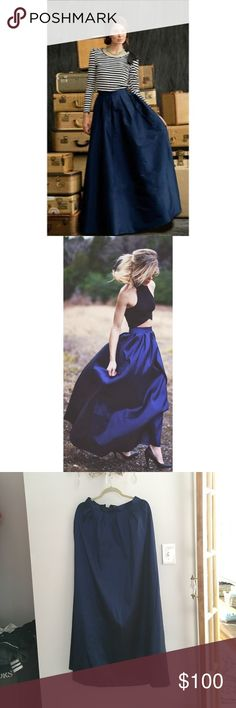 """Deep Blue Taffeta Maxi Skirt Absolutely gorgeous, full deep blue taffeta skirt. Color is fascinating, less navy and more like an indigo or the color of a blue velvet ribbon. Waist is 27.5"""", and hits at natural waist. Style is """"Shabby Apple First Snow Skirt"""" but it's almost exactly the same (minus the bow) as the """"Shabby Apple Southern Flair Skirt"""". Brand is not ModCloth, it's Shabby Apple. ModCloth Skirts Maxi"""