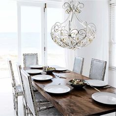 A new idea for the world of classical illumination, designed by Christian Piccolo for MM Lampadari in Italy. Elegant shapes forged in iron decorated with a fascinating design gives this chandelier a modern line. Lighting Online, Lighting Design, Table Settings, Dining Room, Chandelier, Iron, Christian, Italy, Shapes