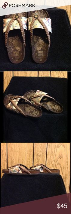 Muk Luk Sandals NWOT Up for grabs is a super comfy new pair of stylish Muk Luk sandals, featuring brown rope leather upper, with Metallic flowers 🌺 on the band. The footbed isn't memory foam, but close to it because your feet just sink comfortably into the footbed. Muk Luks Shoes Sandals