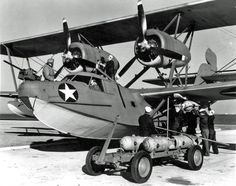 Personnel load depth charges onto a Coast Guard flying boat on the ramp at Coast Guard Air Station (CGAS) Floyd Bennett Field, New York, in 1943 Navy Aircraft, Military Aircraft, Sea Planes, Aviation World, Elizabeth City, Ww2 Pictures, Flying Boat, Us Air Force, Coast Guard