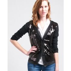 Cutest sequined cardigan! Perfect for holidays! Long sleeved black sequin cardigan. Worn once. Great condition. Great with skirts or dresses- can even be dressed down with jeans! Costa Blanca Sweaters Cardigans
