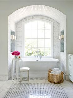 Slipper Tub Surrounded by Marble in an Elegant, Traditional Bathroom >> http://www.hgtv.com/design-blog/design/12-budget-ways-to-live-luxe-in-your-bathroom?soc=pinterest