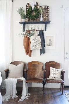 Showcasing vintage finds in a landing spot grounds this transitional space by adding a bit of history. The row of charming theater seats above was a splurge uncovered in a thrift store by Karen of Perfecting the Homefront.