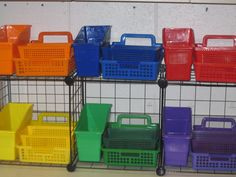 Each group is assigned colored baskets of materials for their group. Each table also has a basket for sorting manipulatives and a bin for holding spiral notebooks. Fantastic idea