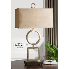Table lamp has coordinating floor lamp . Uttermost