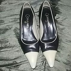 CHANEL Kitten Heels Shoes Size 7 Beautiful shoes by Chanel. Black and ivory soft lambskin  leather with stylish kitten heels. Shoes have just been serviced and are good to go. Size 7. Normal wear. Bottom tips have been replaced. CHANEL Shoes Heels