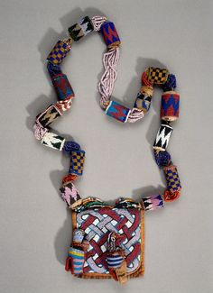 Beaded necklace from the Yoruba people of Nigeria | Leather, cloth, glass beads, cotton thread