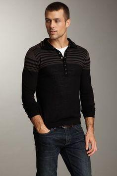 Dark sweater w/horizontal stripes on shoulders--this look makes shoulders look broader.  works w/dark jeans, white t-shirt