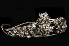 A white metal and diamond set floral cluster tiara (A/F)