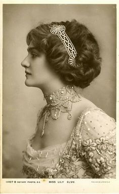"Miss Lily Elsie, a Popular English Edwardian Actress & Dancer wearing a Greek Style Headband and High Necklace. She was best known for her starring role in Franz Lehar's Operetta ""The Merry Widow""..."