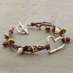Handmade Heart, cultured pearls, faceted garnet, copper and thai silver beads. (http://www.elizabethplumbjewelry.com/multiple-strands-and-silver-heart-bracelet/)
