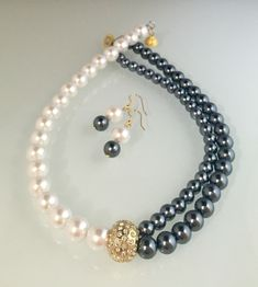 Japanese pearls, gold plated CZ studded pendant, magnetic clasp.