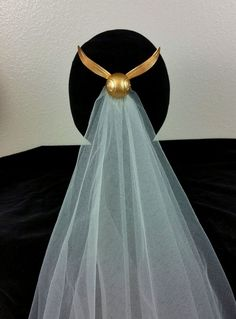 Harry Potter Golden Snitch hair comb and bridal veil. Custom created by Christopher Morgan Couture. Harry Potter wedding ideas. Order yours at ChristopherMCouture my Etsy shop.