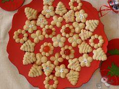 Biscotti natalizi di frolla montata all'arancia con spara biscotti perfetti con il the per la merenda o la colazione