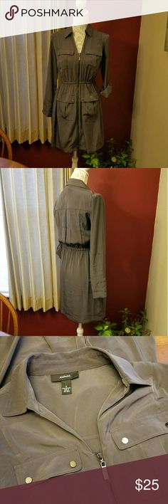 Alfani Dress Military style in olive green. Easy care polyester. Snap tab sleeves with elastic waist and full zip front. Lightweight and great for layering. Looks amazing with camouflage camisole, black leggings and boots! EUC Alfani Dresses