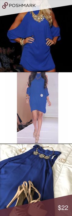 Royal blue cut out dress This royal blue cut out dress is super stylish and fun to wear. Easy to accessorize! Only worn once. Open arm sleeves. I reccomend wearing a black bandeu underneath in case you're worried about showing skin. 2nd pic is me competing in this dress for opening number :) Size is small. Great condition. Dresses