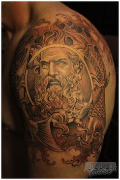 Shoulder tattoo.  Helios (Greek sun god) in place of the circle of Yin and Yang.  Great detail.