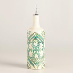 Hand painted in India with our ornate design, our exclusive ceramic oil and vinegar storage bottle features an airtight gasket and a drip-free pouring spout. www.worldmarket.com #CelebrateOutdoors