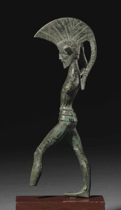 AN ETRUSCAN BRONZE WARRIOR - UMBRIA, CIRCA 450-400 B.C.