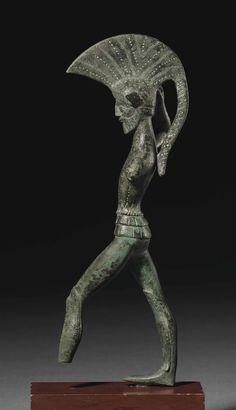 ETRUSCAN BRONZE WARRIOR - UMBRIA, CIRCA 450-400 B.C.