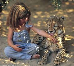 Real life Mowgli: Photos of Tippi, a girl who spent the first ten years of her life growing up in the African bush, have been released for t...