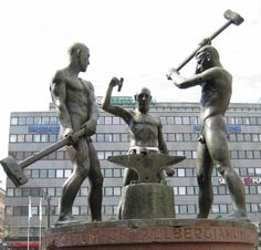 Three Smiths Statue. The statue was damaged in a bombing during the Continuation War in 1944. Marks of the damage can still be seen in the base of the statue, and the anvil has a hole caused by a bomb shrapnel. Helsinki, Finland