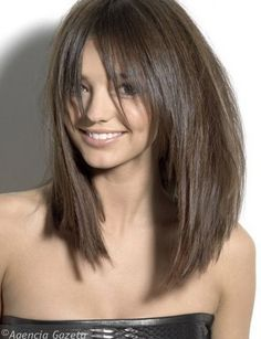 Long razor-cut brunette bob with bangs