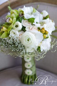 Beautiful green and white bridal bouquet with orchids, ranunculus, sweet peas and babys breath Keywords: Wedding bouquet bridal bouquet #wedding #bouquet #bridal #flowers