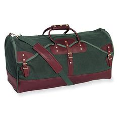 Large duffle bag, green canvas with brown leather trim.