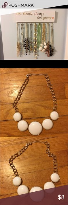 White statement necklace White and gold. Never been worn. ☀️☀️☀️Will accept offers on any other necklaces you see. Let me know which ones and I will take separate pictures and list them individually. ☀️☀️☀️ Jewelry Necklaces