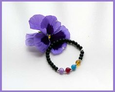 A Mother's Bracelet made with Gemstone beads to represent the birth months.