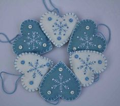 Felt Christmas decorations. Set of 3 Embroidered  Snowflake Heart ornaments.. --- via Etsy.