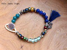 Striped Czech glass, glass beads, silver metal and lotus flower button bracelet. Andria Bieber Designs #bracelet #jewelry #boho #andriabieber #handmade