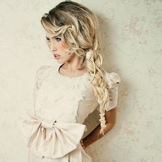 long braided hairdo with some embellishments - love this white bow dress